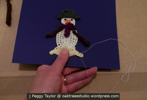 Crochet card tutorial - using stab stitch to attach the snowman to the card